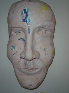 "Self-portrait 1 - 2010 Newspaper, plaster, acrylic paint. 16"" x 24"""