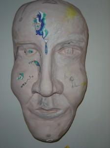 "Self-portrait 1 - 2010 Newspaper, plaster, acrylic paint. 16"" x 24"""
