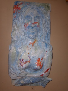 "Self Portrait 2 - 2011 Newspaper, plaster, acrylic paint. 18"" x 40"""